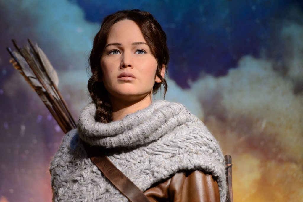 Madame Tussauds London today revealed its newest figure, Katniss Everdeen, protagonist of the worldwide phenomenon The Hunger Games franchise, in its own immersive backdrop. Following the release of The Hunger Games: Mockingjay - Part 1, Madame Tussauds has also launched wax likenesses of Katniss, portrayed by Academy Award® winner Jennifer Lawrence, at its New York and Hollywood attractions. London's figure portrays Katniss' in her hunting outfit, which she wears in the second installment of the franchise, The Hunger Games: Catching Fire. Teamed with her iconic brown leather hunting jacket, are dark charcoal trousers, knee-length tie-up leather brown boots, plus brown leather quiver (arrow bag) and trademark bow. Her hair is also styled in her iconic braid.