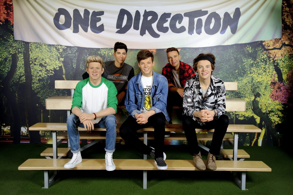 Hot on the heels of the band's announcement of a concert of their 'Where We Are' international stadium tour, Madame Tussauds London have restyled the phenomenally popiular wax figures of pop sensation, One direction, with a new look for the summer to reflect the outfits worn by the group on tour.